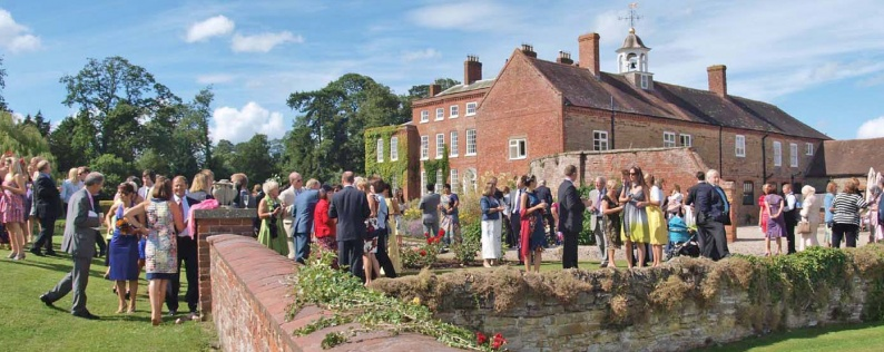 Wedding guests in garden at country wedding venue West Midlands
