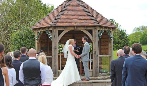 Bride and groom getting married at outdoor Shropshire wedding venue